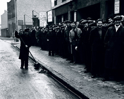 Queue of unemployed men, London, 12 December 1938.