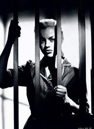 Diana Dors behind bars in 'Yield to the Night', her first serious role, 1956.