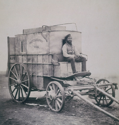 Fenton's asistant, Marcus Sparling, on the photographic van, Crimea, c 1855.