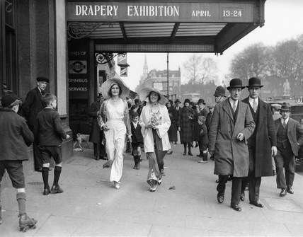 Models wearing beach costumes walking in the street, 13 April 1931.