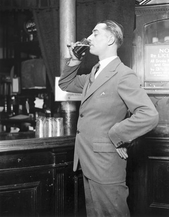 Man drinking a glas of beer, 23 April 1931