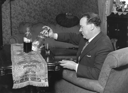 Man syphoning soda into whiskey, 23 April 1931.