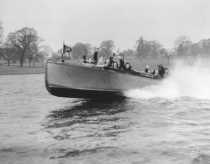 Amy Johnson in a new speedboat, Welsh Harp, Hendon, 1 April 1931.