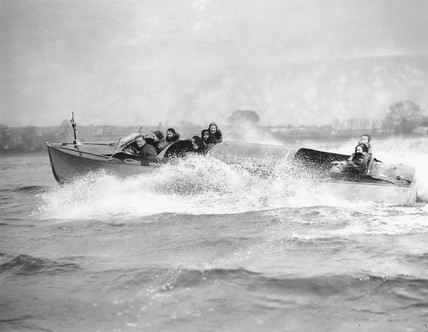 Amy Johnson in a new speedboat, 'Welsh Harp', Hendon, 1 April 1931.