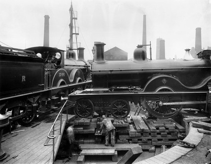 Steam locomotive being jacked up to track level after an accident, c 1895.