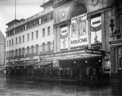 People queuing in the rain, Empire cinema, London, 3 May 1931.