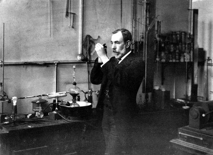 Sir William Ramsay standing in his laboratory, c 1900.