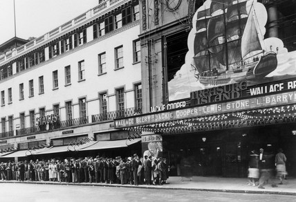 Queueing outside the Empire cinema to see 'Treasure Island', London, 1934.