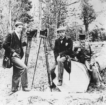 Three men with field cameras on location, c 1880.