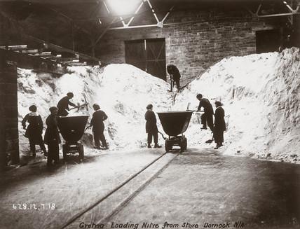 Women workers breaking up a heap of nitre, Dornock, Scotland, 1918.