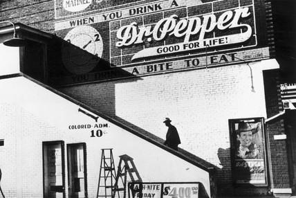 A black man entering a movie theatre's 'col