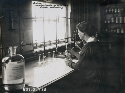Woman worker in laboratory at Gretna munitions factory, Scotland, 1918.