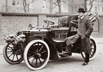 C S Rolls standing beside a 20 hp Panhard motor car, 1903