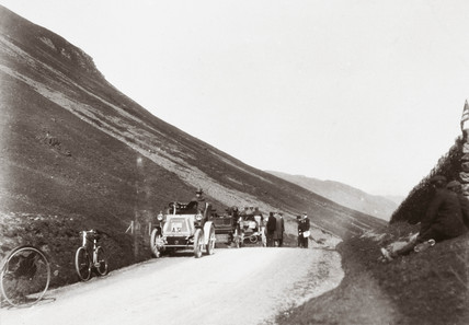 Motor cars parked along a road in the hills during 1000 Mile Trial, 1900.