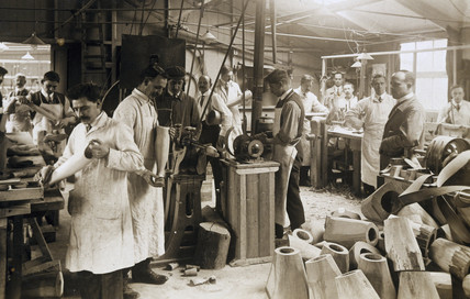 Making wooden prosthetic limbs during World War One, c 1915-1918.
