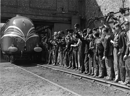 Steam locomotive 'The Coronation' being cheered by workers, 25 May 1937.