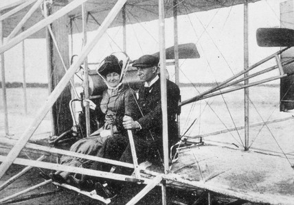 Wilbur Wright and Madame Hart Berg seated in a flying machine, early 1900s.