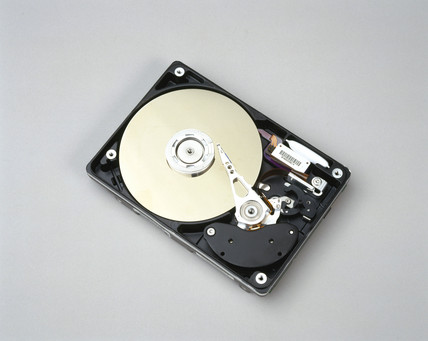 Interior of hard disk drive taken from a PC, c 1998.