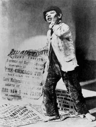 Newspaper boy with placard, 1871.