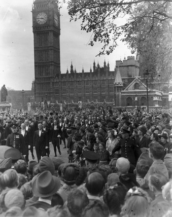 Churchill in a crowd as he makes his way to