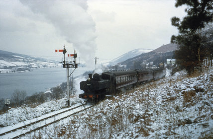Steam train in a snowy landscape, Wales, 29 December 1962.