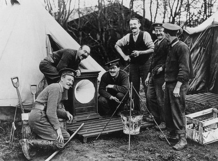 British Soldiers with their Christmas gift of a gramophone, France, 1914-1918.