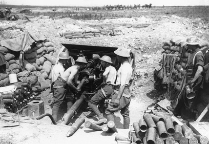 Soldiers loading ammunition into a gun, Wes