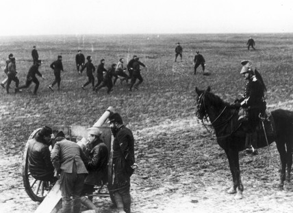 French soldiers playing football with a poi