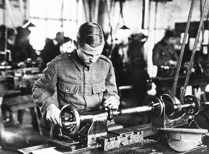 School boys working on munitions, WWI. Boy