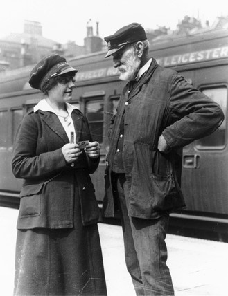 Female ticket inspector and an elderly rail