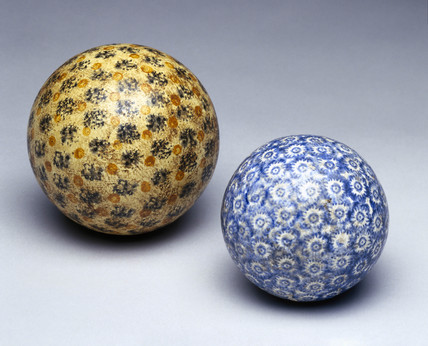 A pair of carpet bowls, 19th century.