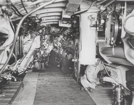 Sailors at work in the interior of a British submarine, 1914-1918.