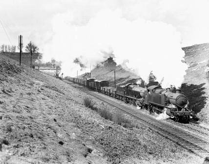 GWR '31xx' 2-6-2T locomotive asisting a '28xx' 2-8-0 goods engine, c 1930.