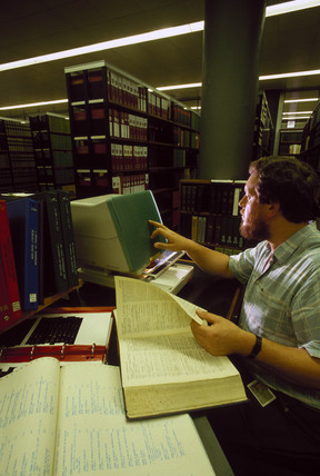 Librarian responding to a reader's enquiry, Science Museum Library, 1988.
