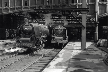Two Coronation Clas steam locomotives at Carlisle, July 1953.