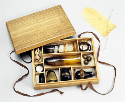Collection of sexual aids in a wooden box, Japanese, 1930-1935.