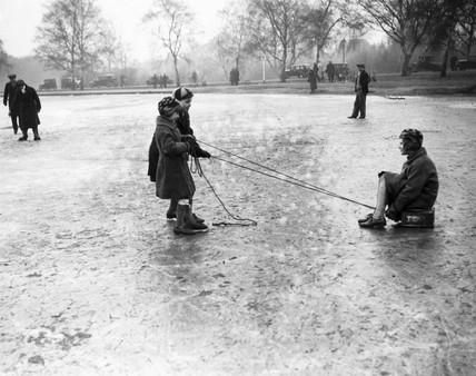 Children playing on a frozen pond, Wimbledon, London, 27 January 1932.