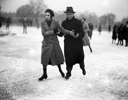 A couple ice skating, Wimbledon, London, 27 January 1932.