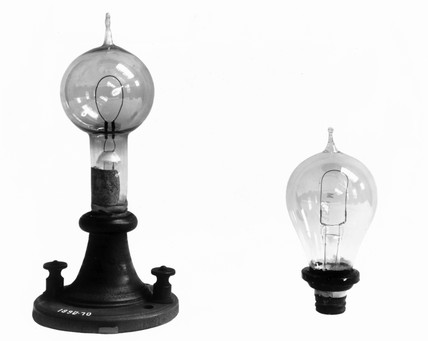 Edison's filament lamp (left) shown with bulb, c 1880.