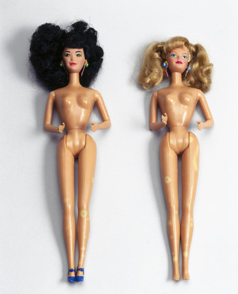 Two undresed Barbie dolls, late 1970s and late 1980s.