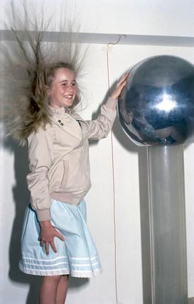 Girl holding a Van de Graaf generator, 1998.