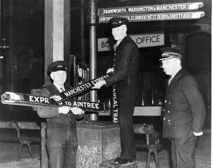 Staff collect finger boards after the last train, Lord Street Station, Southport, c.1952.