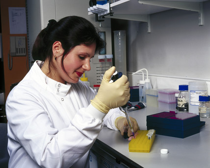 Setting up a polymerase chain reaction (PCR), Institute of Child Health, London, May 2000.