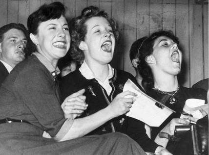 Three girls shout with joy while listening to Frankie Laine, 1953.