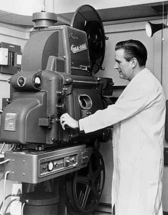 House engineer with Cinemeccanica projector, Odeon Cinema, c 1950s.