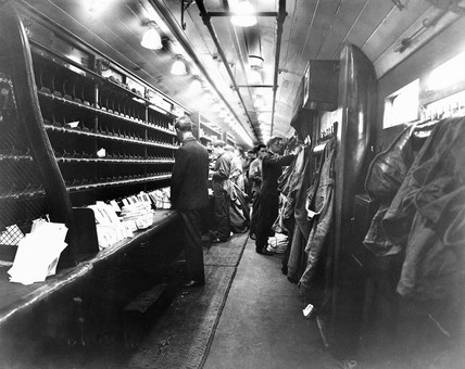 Postal workers sorting mail, c 1929.