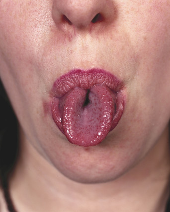 Woman rolling her tongue.