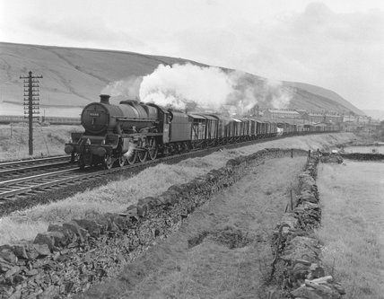 BR steam locomotive 'Howe' with a northbound goods train, 1960s.