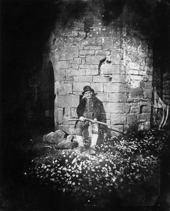 Gamekeeper sitting with daisies, c 1840s.