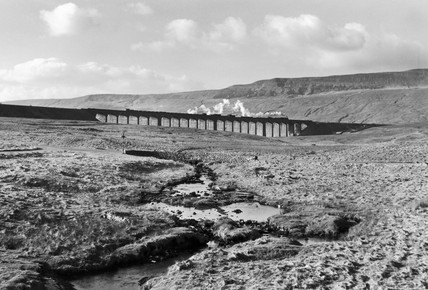 A goods train crosing the Ribblehead Viaduct, North Yorkshire, c 1950s.